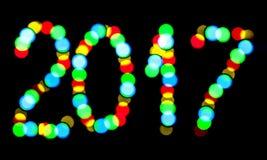 Lumières brouillées écrites de la bonne année 2017 Image stock