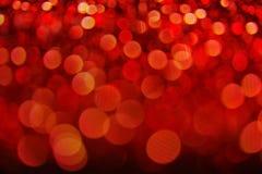 Lumières brouillées brillantes de Glister de bokeh de fond de concept de l'espace rouge abstrait de copie, fond de Noël photos stock