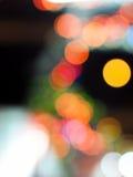 Lumières brouillées comme la lune entourée par le bokeh Photos stock