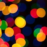 Lumières colorées de bokeh de guirlande de Noël Images stock