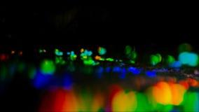 Lumières colorées de panneau d'affichage de ville de nuit de fusée de lentille banque de vidéos