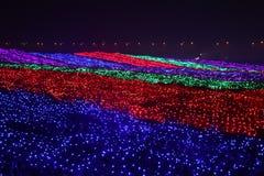 Lumières colorées la chute d'arc-en-ciel Photographie stock libre de droits