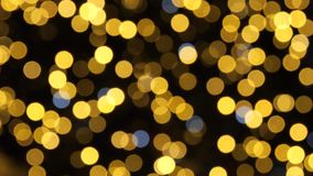 Lumières courantes colorées de bokeh dans l'illumination de nuit de nouvelle année banque de vidéos