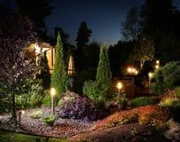 Lumières d'illumination de jardin Photographie stock libre de droits