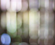 Lumières de bokeh de Blured dans une rangée Fond defocused abstrait Images stock