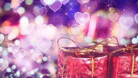 Lumières de bokeh de boîte-cadeau et de coeur Photographie stock
