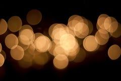 Lumières de bokeh de Goldenl de guirlande de Noël Fond brouillé Photo stock