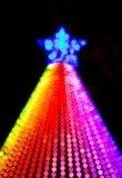 Lumières de couleur d'arc-en-ciel d'arbre de Noël Photos libres de droits