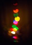 Lumières de couleur sur l'arbre de Chriistmas Photographie stock libre de droits