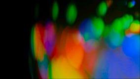 Lumières de disparition de tache floue de poutre de fusée colorée de lentille banque de vidéos
