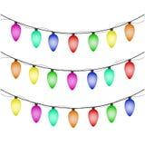 Lumières de Noël colorées sur le fond blanc Photos libres de droits