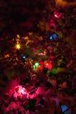 Lumières de Noël dans la neige Photographie stock
