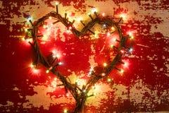 Lumières de Noël de forme de coeur d'amour de concept de vacances Photographie stock
