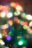 Lumières de Noël, fond unfocused images stock