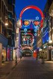 Lumières de Noël sur la rue de Carnaby, Londres R-U Image stock