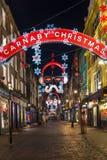 Lumières de Noël sur la rue de Carnaby, Londres R-U Photo stock