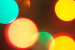 Lumières de Noël unfocused colorées Photographie stock