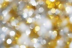 Lumières de vacances d'argent et d'or Image stock