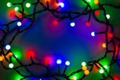 lumières defocused d'image de Noël d'ampoules de fond Images stock