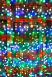 Lumières Defocused de Noël sur la fenêtre Photo stock