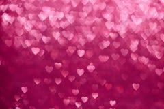 Lumières Defocused de scintillement roses de fond de coeurs Photos stock