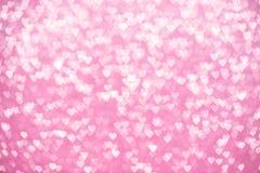 Lumières Defocused de scintillement roses de fond de coeurs Images stock