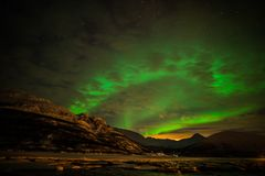 Lumières du nord dans le Troms image stock