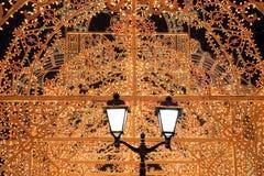 Lumières et lanterne d'or de fond de Noël Images stock