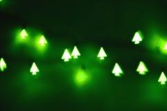Lumières formées d'arbre de Noël, bokeh Photos stock