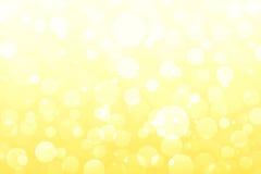Lumières jaunes et d'or abstraites, milieux de bokeh Images stock