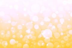 Lumières jaunes, oranges, d'or abstraites, fond de bokeh Images stock