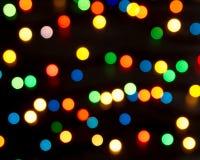 Lumières multicolores sur un fond foncé Image libre de droits