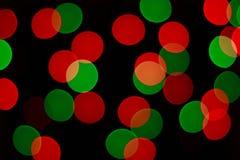 Lumières rouges et vertes de bokeh de guirlande de Noël Backgro brouillé Photos stock