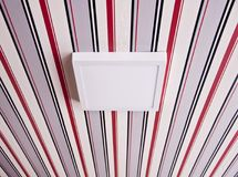 Luminaire lamp on the striped ceiling Royalty Free Stock Images