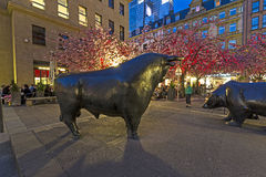 Luminale 2014 - illuminated stock exchange with statues of bull and bear at night in Frankfurt Stock Photography