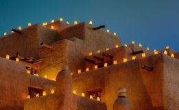 Luminaria on adobe building. Large adobe building with holiday lights at dusk in Santa Fe, New Mexico Royalty Free Stock Images