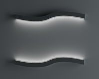 Luminaries glowing on a dark wall, highlighting a place for a poster. 3d rendering Royalty Free Stock Photography