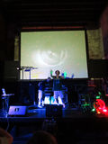 Luminaries rap on stage with trippy video show overhead in clu. HONOLULU - APRIL 25:  Luminaries rap on stage with trippy video show overhead in club in Stock Image