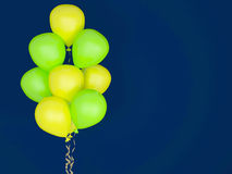 Luminescent balloons on blue background. Celebration concept. 3d render. Greeting Card Stock Photography