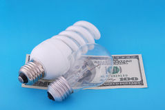 Luminescent and electric lamp on hundred dollars Stock Photography