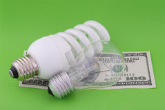 Luminescent and electric lamp on hundred dollars Royalty Free Stock Photo