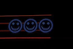 Luminous blue electric circles with eyes and smiles Royalty Free Stock Photos