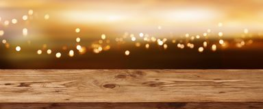 Free Luminous Bokeh Background With Wooden Table Stock Images - 134208224