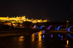 Luminous bridge arches and  medieval ramparts Royalty Free Stock Images