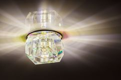 Luminous ceiling light. Ceiling lighting, rays from the lamp Royalty Free Stock Image