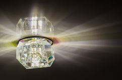 Luminous ceiling light. Ceiling lighting, rays from the lamp stock image