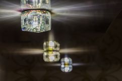 Luminous ceiling light. Ceiling lighting, rays from the lamp Stock Photos