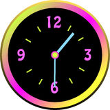 Luminous clock face with colorful case Royalty Free Stock Images