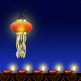 Luminous Diwali Lamp. Happy Diwali Illustration: A shiny Diwali lamp with red diyas (cup-shaped indian oil lamps) with an ornamental border on a night sky