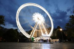 Luminous Ferris wheel in night city. Budapest Eye at night. royalty free stock photo